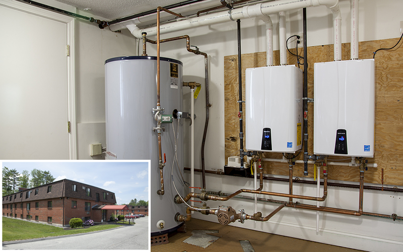 Water heating systems for roosevelt apartments in new hampshire use two navien npe condensing tankless water heaters with a storage tank
